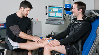 Linking page research two people in muscle diagnostics in a leg press